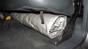 The kit stored under the rear seat.  Takes very little room!
